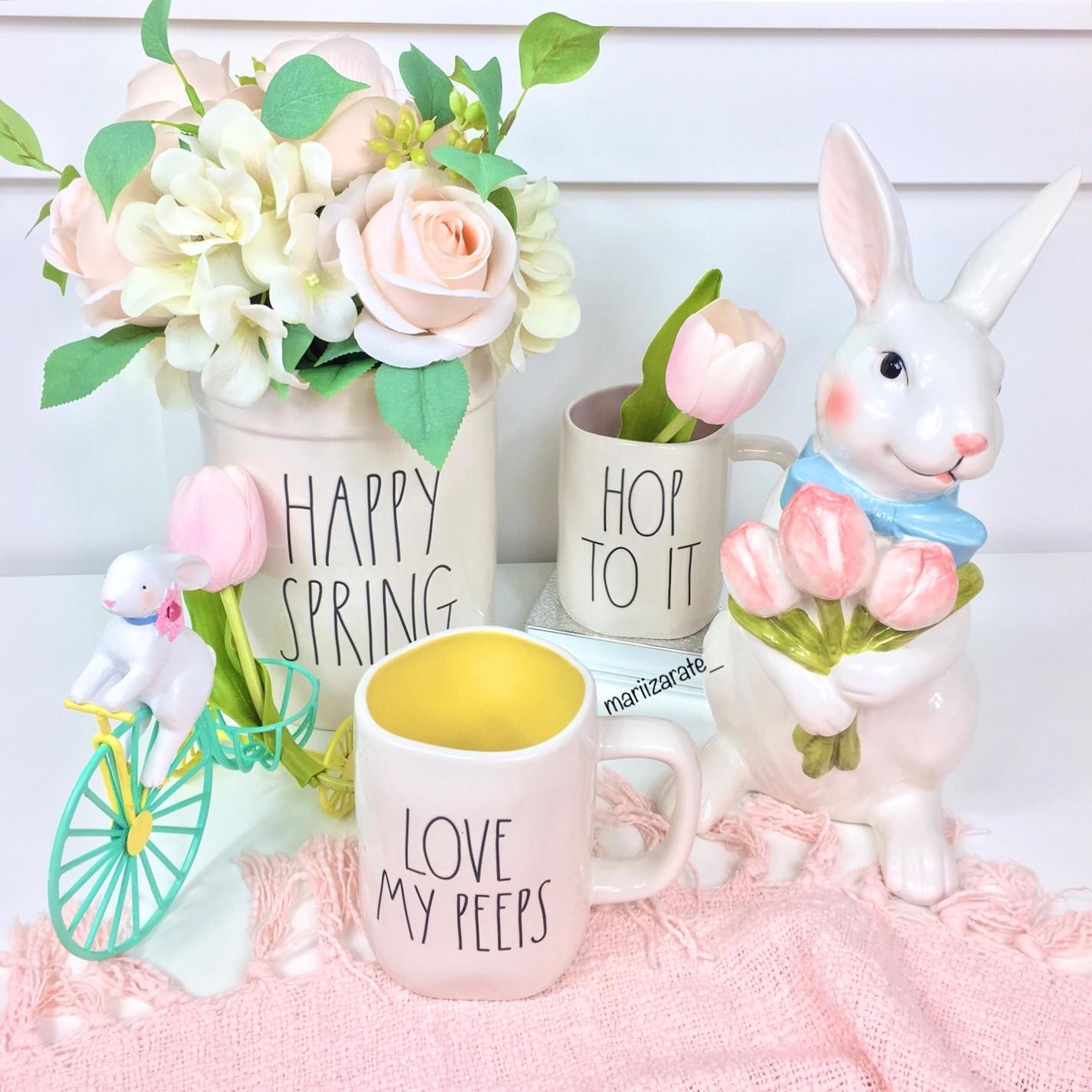 Spring inspired home decor, including a bunny statue.